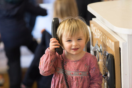 Child on phone in Henley nursery