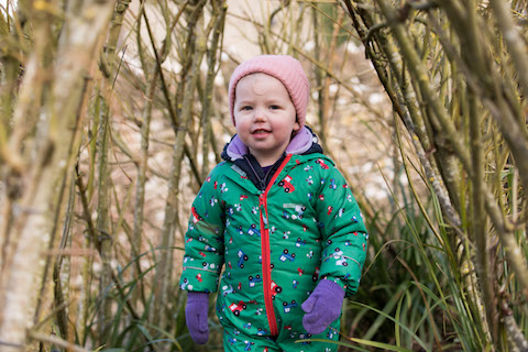 Forest School child playing at nursery