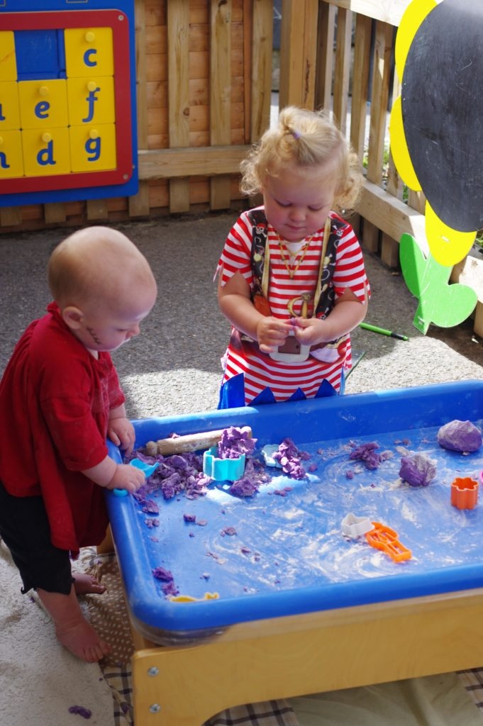 Nursery children playing outdoors