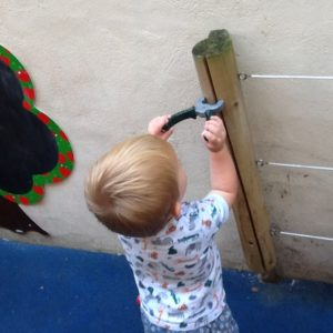 Child playing with tools at Iver nursery