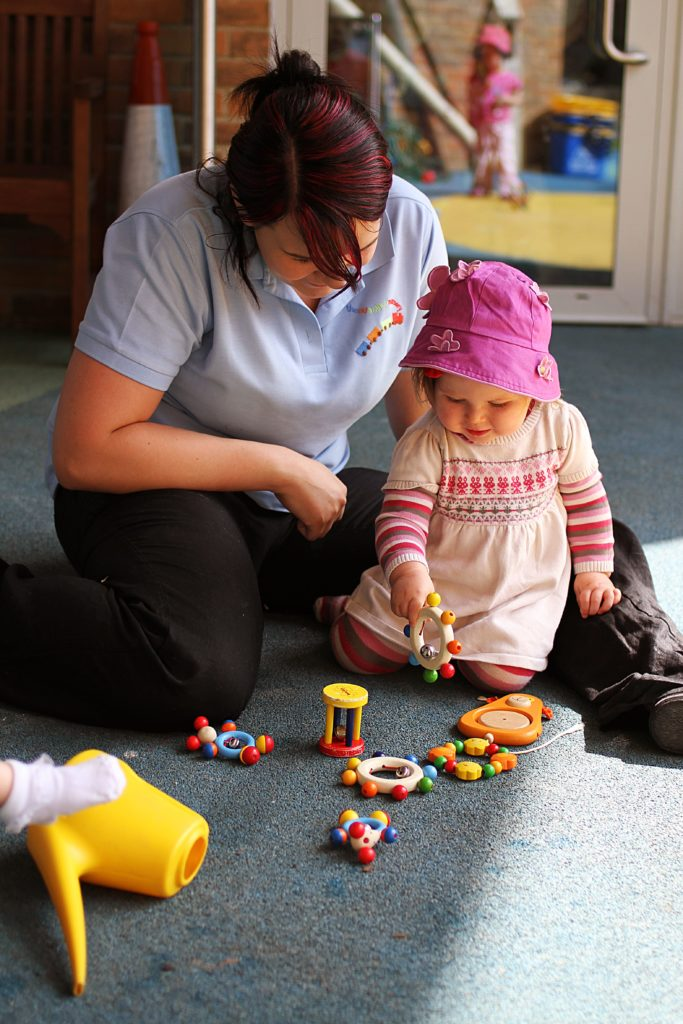 Uxbridge day care nursery staff with a child