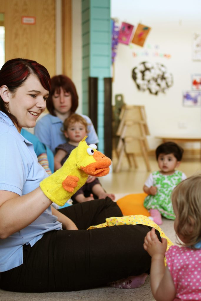 Nursery staff entertaining children