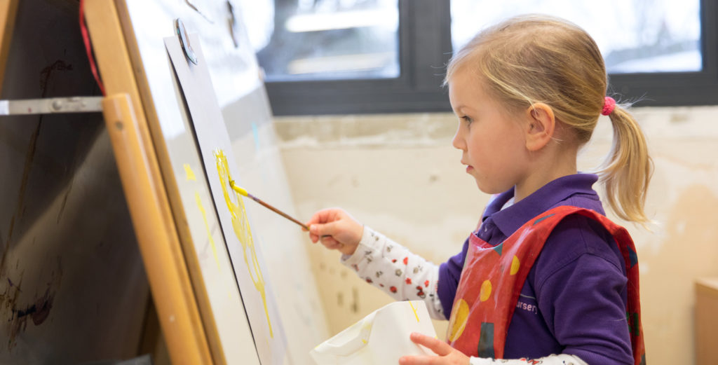 Child painting at nursery